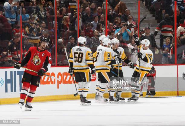 Kris Letang Brian Dumoulin Sidney Crosby and Patric Hornqvist of the Pittsburgh Penguins celebrate a third period empty net goal as Erik Karlsson of...