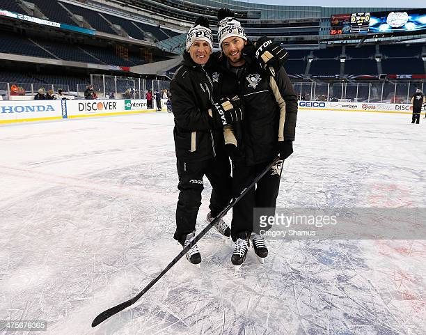 Kris Letang of the Pittsburgh Penguins and Assistant Coach Tony Granato pose for a photo during the 2014 NHL Stadium Series family skate on February...