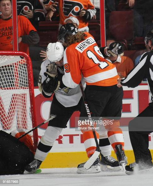 Kris Letang of the Pittsburgh Penguins and Scott Hartnell of the Philadelphia Flyers mix it late in the third period at the Wachovia Center on...