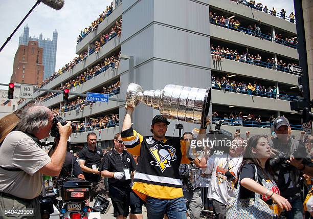 Kris Letang of the Pittsburgh Penguins celebrates during the Victory Parade and Rally on June 15 2016 in Pittsburgh Pennsylvania