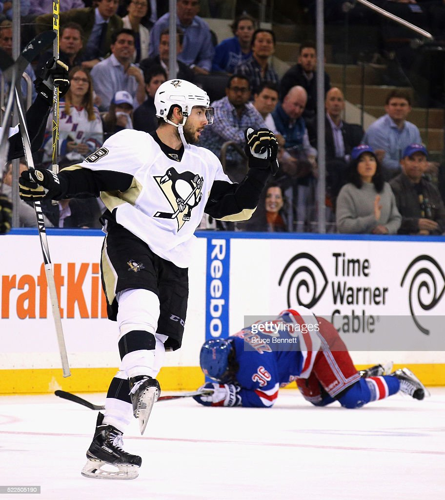 Kris Letang of the Pittsburgh Penguins celebrates his empty net goal at 1947 of the third period as Mats Zuccarello of the New York Rangers hits the...