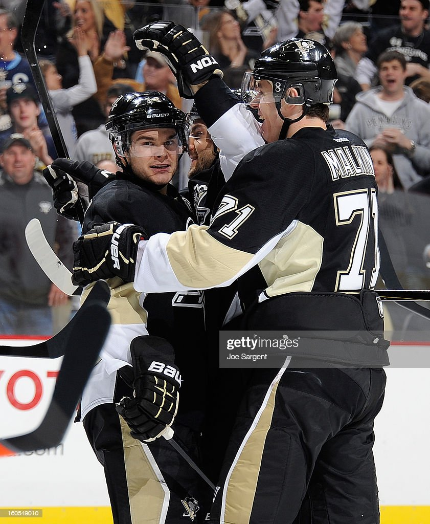 <a gi-track='captionPersonalityLinkClicked' href=/galleries/search?phrase=Kris+Letang&family=editorial&specificpeople=3966336 ng-click='$event.stopPropagation()'>Kris Letang</a> #58 of the Pittsburgh Penguins celebrates his goal with <a gi-track='captionPersonalityLinkClicked' href=/galleries/search?phrase=Chris+Kunitz&family=editorial&specificpeople=604159 ng-click='$event.stopPropagation()'>Chris Kunitz</a> #14 and <a gi-track='captionPersonalityLinkClicked' href=/galleries/search?phrase=Evgeni+Malkin&family=editorial&specificpeople=221676 ng-click='$event.stopPropagation()'>Evgeni Malkin</a> #71 during the game against the New Jersey Devils on February 2, 2013 at Consol Energy Center in Pittsburgh, Pennsylvania. Pittsburgh won the game 5-1.