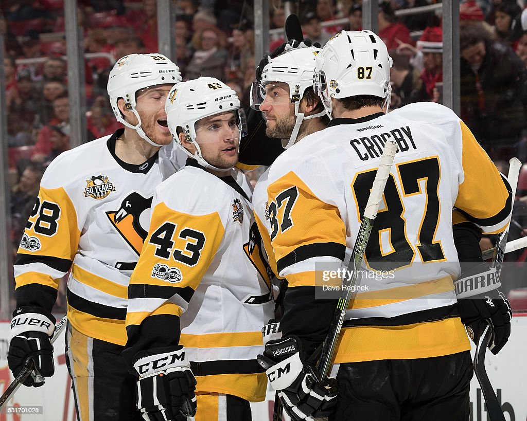 Kris Letang #58 of the Pittsburgh Penguins celebrates his goal with teammates Ian Cole #28, Conor Sheary #43, and Sidney Crosby #87 during an NHL game against the Detroit Red Wings at Joe Louis Arena on January 14, 2017 in Detroit, Michigan.