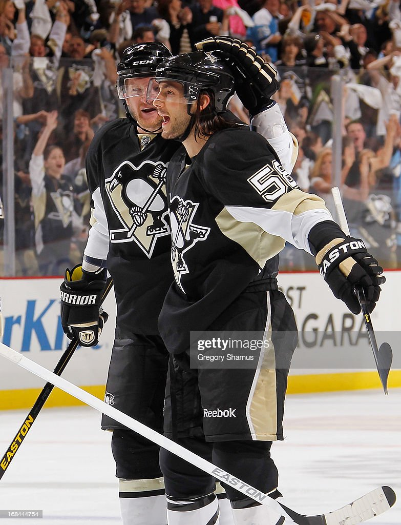 <a gi-track='captionPersonalityLinkClicked' href=/galleries/search?phrase=Kris+Letang&family=editorial&specificpeople=3966336 ng-click='$event.stopPropagation()'>Kris Letang</a> #58 of the Pittsburgh Penguins celebrates his goal with Paul Martin #7 during the third period against the New York Islanders in Game Five of the Eastern Conference Quarterfinals during the 2013 NHL Stanley Cup Playoffs at Consol Energy Center on May 9, 2013 in Pittsburgh, Pennsylvania.