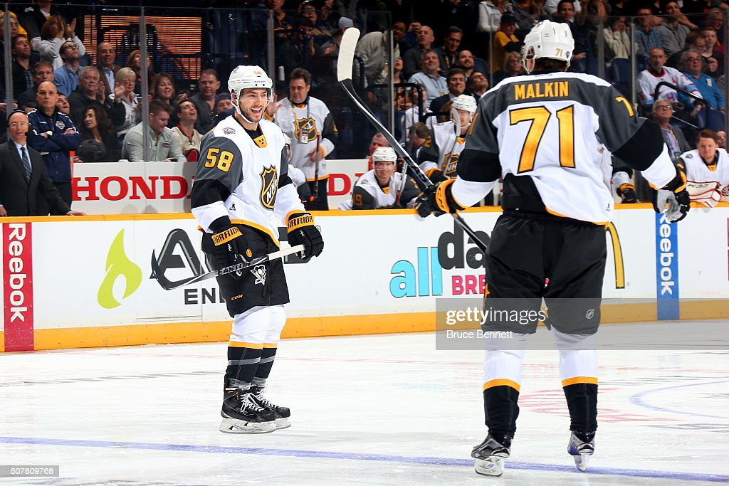 Kris Letang of the Pittsburgh Penguins celebrates with Evgeni Malkin of the Pittsburgh Penguins after scoring a goal during the Eastern Conference...