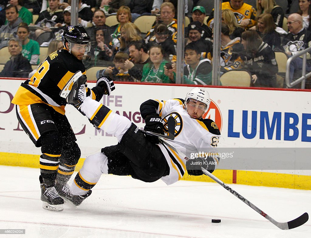 Kris Letang of the Pittsburgh Penguins checks Brad Marchand of the Boston Bruins in the second period during the game at Consol Energy Center on...