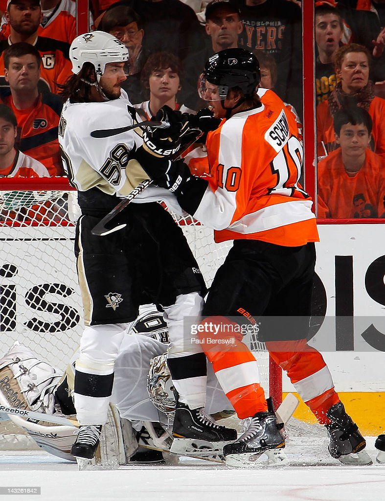 Kris Letang #58 of the Pittsburgh Penguins checks Brayden Schenn #10 of the Philadelphia Flyers in the first period of Game Six of the Eastern Conference Quarterfinals during the 2012 NHL Stanley Cup Playoffs at Wells Fargo Center on April 22, 2012 in Philadelphia, Pennsylvania.