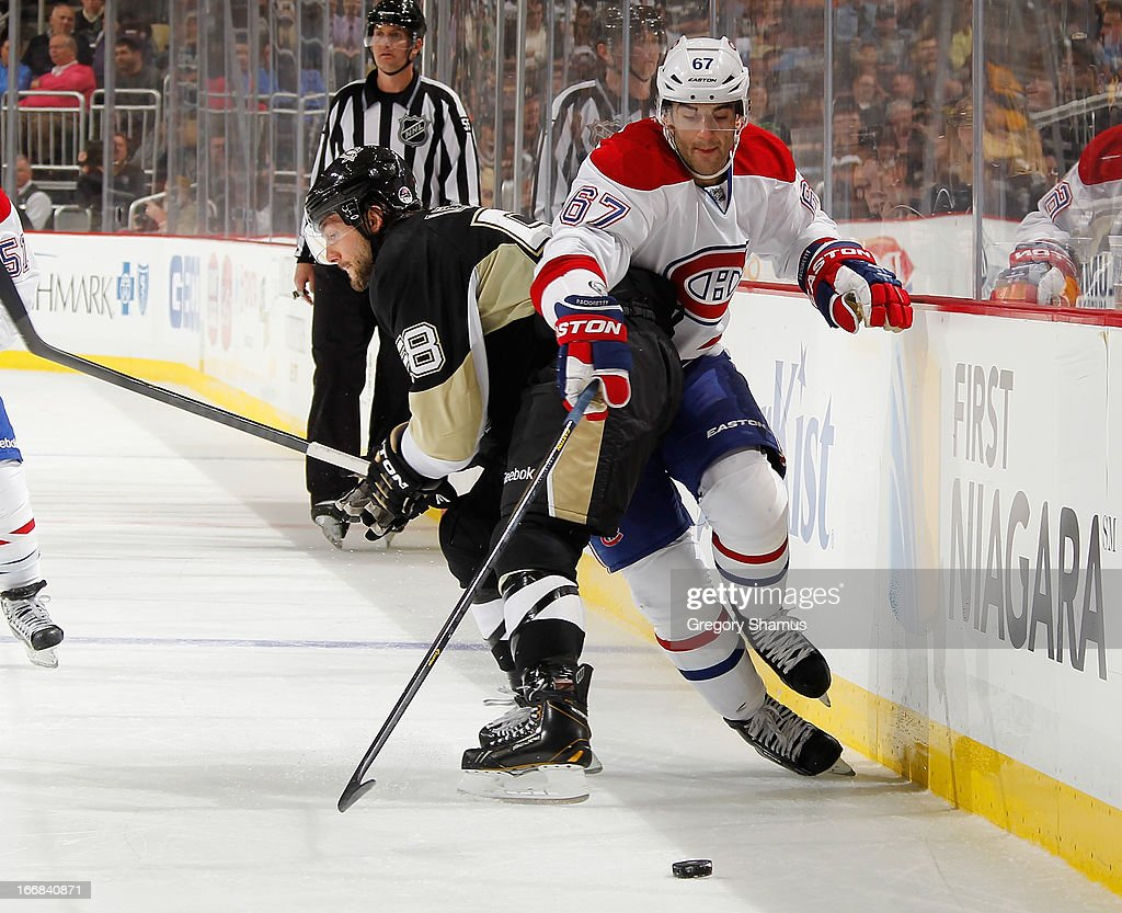 <a gi-track='captionPersonalityLinkClicked' href=/galleries/search?phrase=Kris+Letang&family=editorial&specificpeople=3966336 ng-click='$event.stopPropagation()'>Kris Letang</a> #58 of the Pittsburgh Penguins collides with <a gi-track='captionPersonalityLinkClicked' href=/galleries/search?phrase=Max+Pacioretty&family=editorial&specificpeople=4324972 ng-click='$event.stopPropagation()'>Max Pacioretty</a> #67 of the Montreal Canadiens on April17, 2013 at Consol Energy Center in Pittsburgh, Pennsylvania. Pittsburgh won the game 6-4.