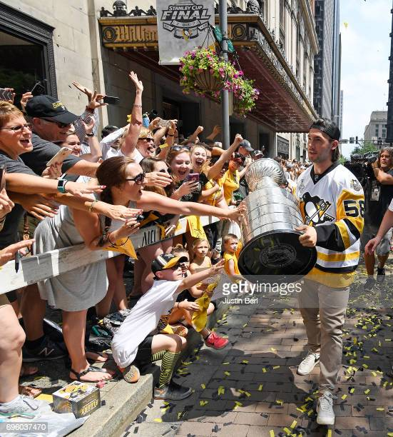 Kris Letang of the Pittsburgh Penguins holds the Stanley Cup for fans to touch during the Victory Parade and Rally on June 14 2017 in Pittsburgh...