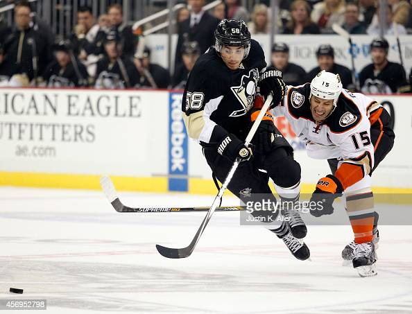 Kris Letang of the Pittsburgh Penguins is tripped by Ryan Getzlaf of the Anaheim Ducks in the first period during the season opener at Consol Energy...