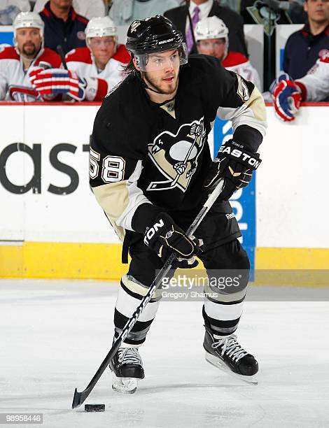 Kris Letang of the Pittsburgh Penguins looks to pass against the Montreal Canadiens in Game Five of the Eastern Conference Semifinals during the 2010...
