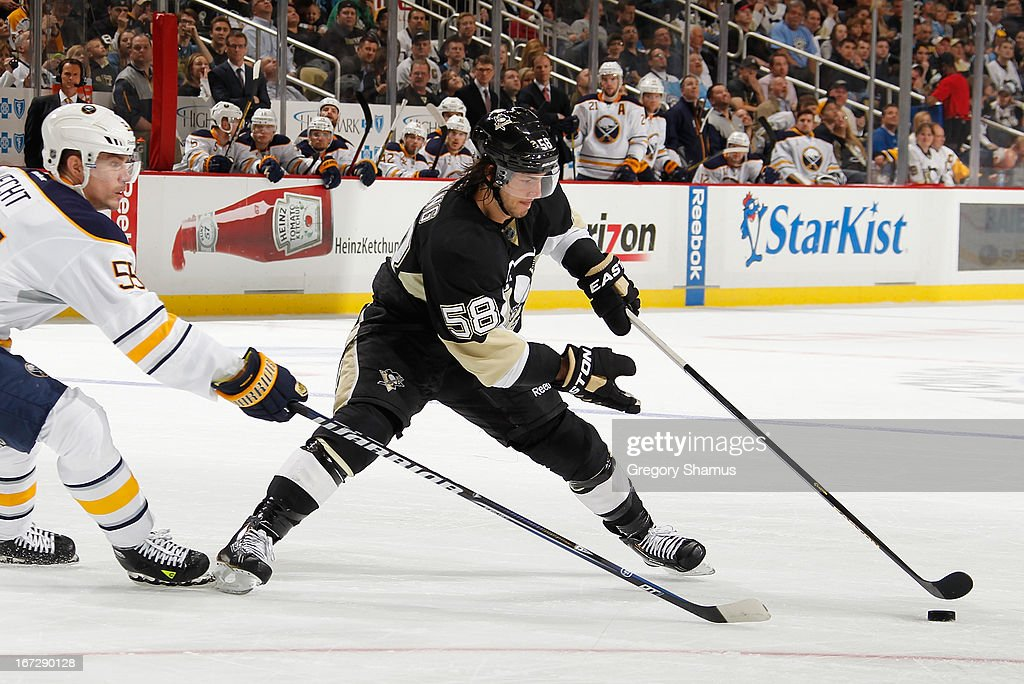 <a gi-track='captionPersonalityLinkClicked' href=/galleries/search?phrase=Kris+Letang&family=editorial&specificpeople=3966336 ng-click='$event.stopPropagation()'>Kris Letang</a> #58 of the Pittsburgh Penguins moves the puck past the defense of <a gi-track='captionPersonalityLinkClicked' href=/galleries/search?phrase=Jochen+Hecht&family=editorial&specificpeople=203184 ng-click='$event.stopPropagation()'>Jochen Hecht</a> #55 of the Buffalo Sabres on April 23, 2013 at Consol Energy Center in Pittsburgh, Pennsylvania.