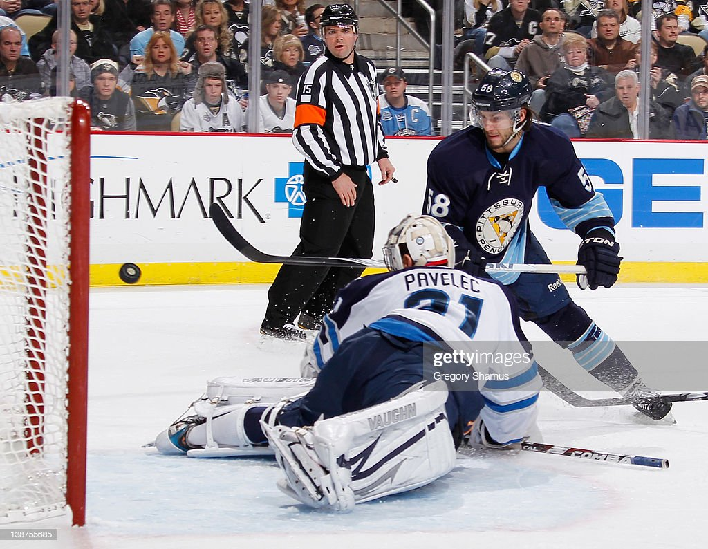 Kris Letang of the Pittsburgh Penguins scores a goal against Ondrej Pavelec of the Winnipeg Jets on February 11 2012 at Consol Energy Center in...