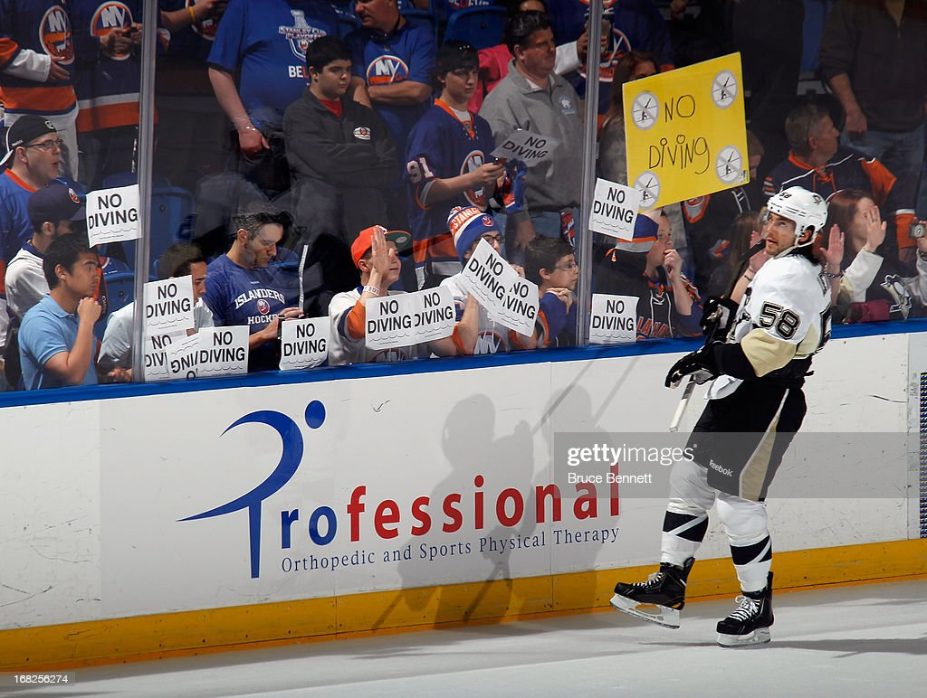 Kris Letang #58 of the Pittsburgh Penguins skates past 'No Diving' signs held by New York Islanders fans prior to Game Four of the Eastern Conference Quarterfinals during the 2013 NHL Stanley Cup Playoffs at the Nassau Veterans Memorial Coliseum on May 7, 2013 in Uniondale, New York.