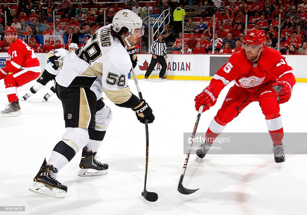 <a gi-track='captionPersonalityLinkClicked' href=/galleries/search?phrase=Kris+Letang&family=editorial&specificpeople=3966336 ng-click='$event.stopPropagation()'>Kris Letang</a> #58 of the Pittsburgh Penguins takes a shot around the stick of <a gi-track='captionPersonalityLinkClicked' href=/galleries/search?phrase=Riley+Sheahan&family=editorial&specificpeople=7029365 ng-click='$event.stopPropagation()'>Riley Sheahan</a> #15 of the Detroit Red Wings during a pre season game at Joe Louis Arena on September 25, 2013 in Detroit, Michigan.