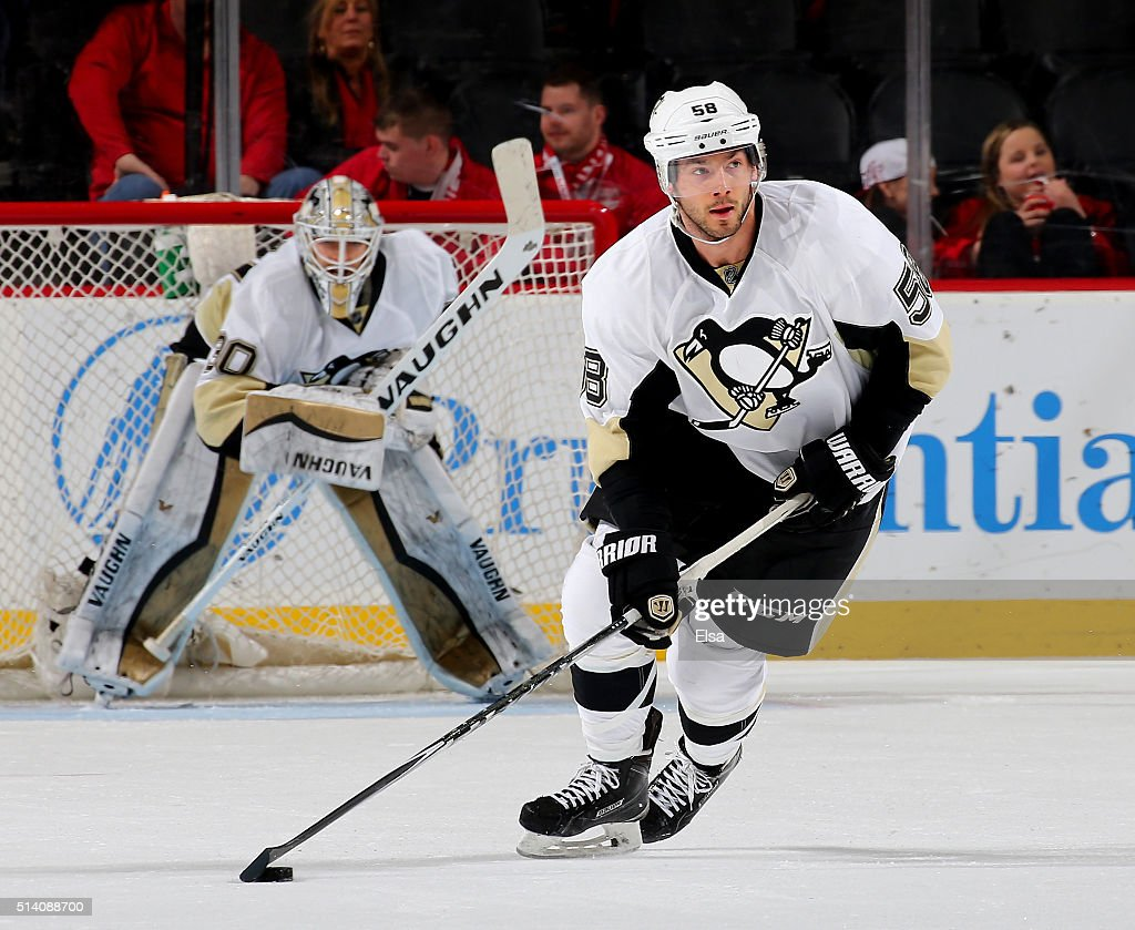 Kris Letang of the Pittsburgh Penguins takes the puck in the third period against the New Jersey Devils on March 6 2016 at Prudential Center in...