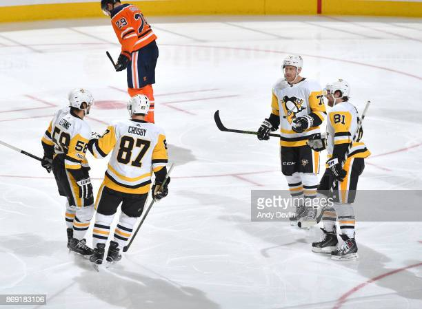 Kris Letang Sidney Crosby Patric Hornqvist and Phil Kessel of the Pittsburgh Penguins celebrate after a goal during the game against the Edmonton...