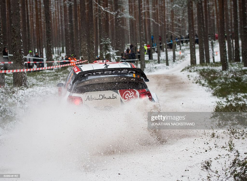 Kris Meeke of Britain and his co-driver Paul Nagle of Ireland steer their Citroen DS3 WRC during the 10th stage of the Rally Sweden, second round of the FIA World Rally Championship on February 13, 2016 in Fredriksberg, Sweden. / AFP / JONATHAN NACKSTRAND