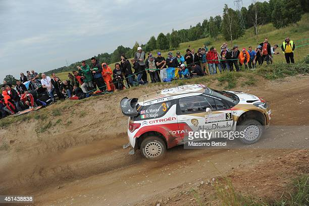 Kris Meeke of Great Britain and Paul Nagle of Ireland compete in their Citroen Total Abu Dhabi WRT Citroen DS3 WRC during Day Three of the WRC Poland...