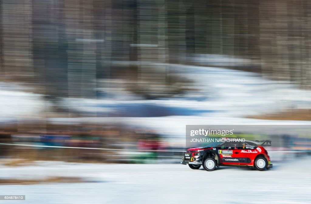 TOPSHOT - Kris Meeke of Ireland and his co-driver Paul Nagle compete in their Citroen C3 WRC during the 18th and final stage of the Rally Sweden, second round of the FIA World Rally Championship on February 12, 2017 in Torsby, Sweden. / AFP / Jonathan NACKSTRAND