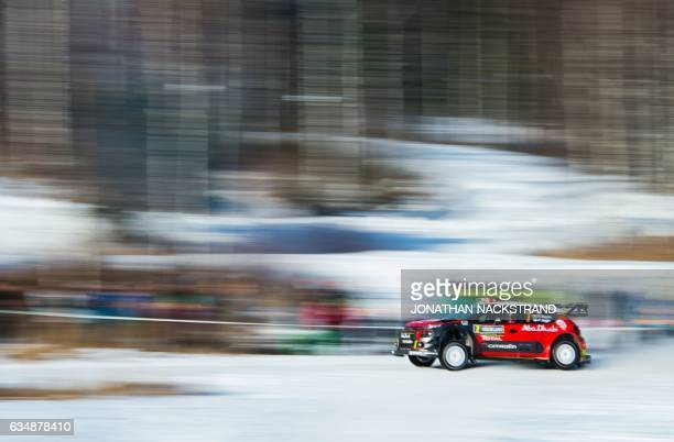 TOPSHOT Kris Meeke of Ireland and his codriver Paul Nagle compete in their Citroen C3 WRC during the 18th and final stage of the Rally Sweden second...