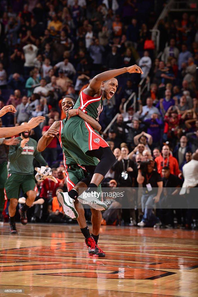 Kris Middleton of the Milwaukee Bucks celebrates his game winning three point goal against the Phoenix Suns on December 15 2014 at US Airways Center...