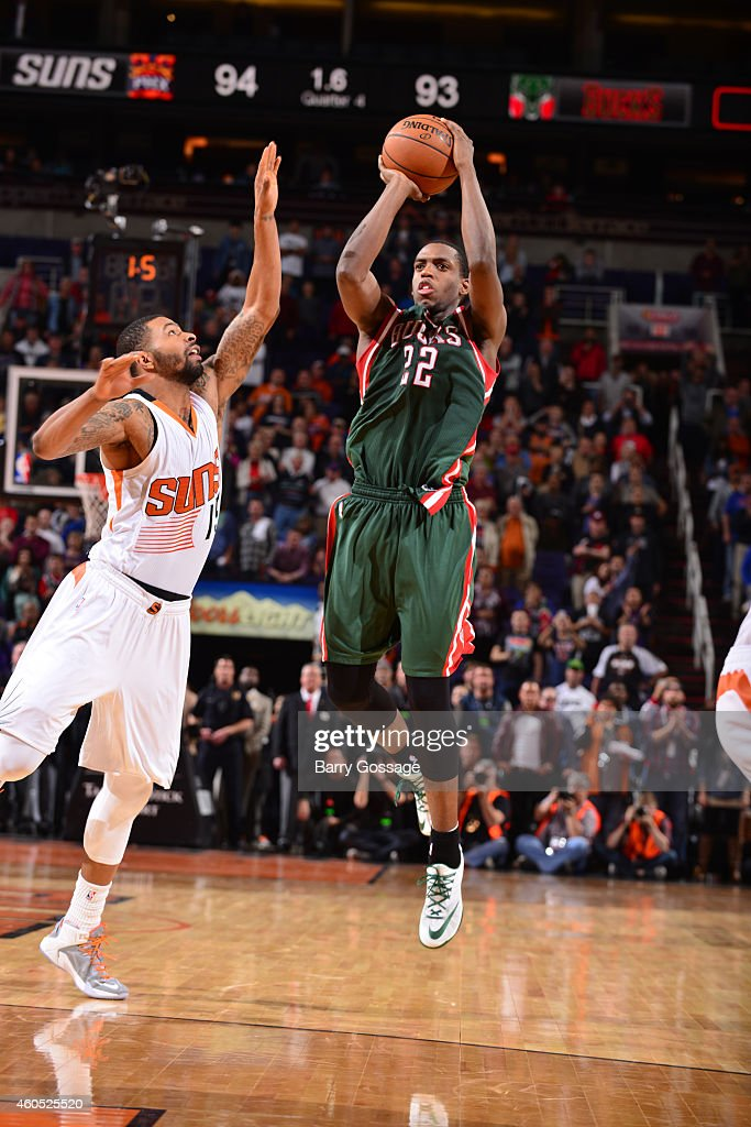 Kris Middleton of the Milwaukee Bucks hits a game winning three point goal against the Phoenix Suns on December 15 2014 at US Airways Center in...