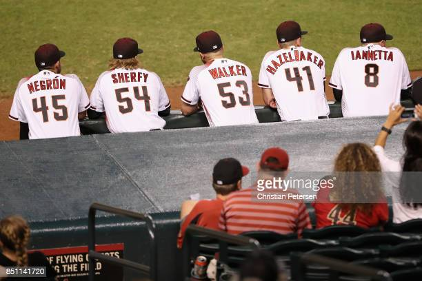 Kris Negron Jimmie Sherfy Christian Walker Jeremy Hazelbaker and Chris Iannetta of the Arizona Diamondbacks lean on the railing during the MLB game...