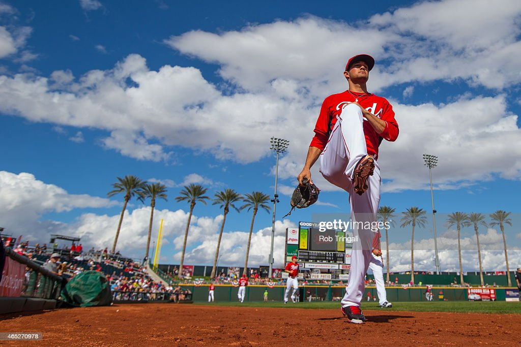 Kris Negron of the Cincinnati Reds stretches during a spring training game against the Cleveland Indians at Goodyear Ballpark on March 3 2015 in...
