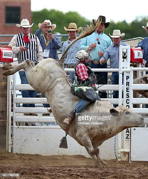 Kris Newman competes in the Bull Riding at the Prescott Frontier Days 'World's Oldest Rodeo' on July 5 2014 in Prescott Arizona