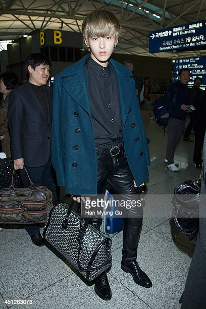 Kris of leading boy band EXOM is seen on departure at Incheon International Airport on November 21 2013 in Incheon South Korea