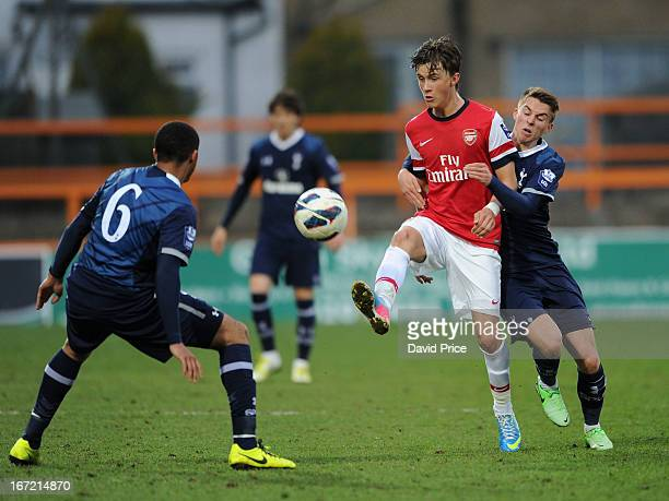 Kris Olsson of Arsenal passes tha ball under pressure from Tom Carroll as Zeki Fryers of Spurs closes in during the Barclays Premier U21 match...