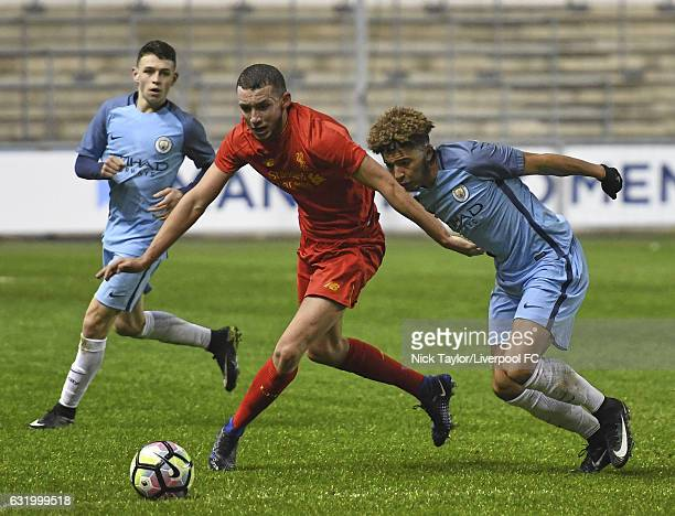 Kris Owens of Liverpool and Jadon Sancho of Manchester City in action during the Manchester City v Liverpool FA Youth Cup game at Etihad Campus on...