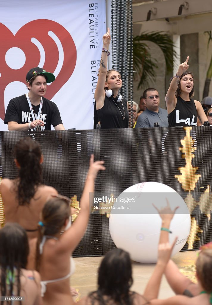Kris 'Rain Man' Trindl, Jahan Yousaf and Yasmine Yousaf of Krewella perform live at the iHeartRadio Ultimate Pool Party Presented by VISIT FLORIDA at Fontainebleau's BleauLive in Miami featuring live performances by Pitbull, Ke$ha, Afrojack, Icona Pop, Krewella and Jason Derulo on June 29, 2013 in Miami Beach, Florida.