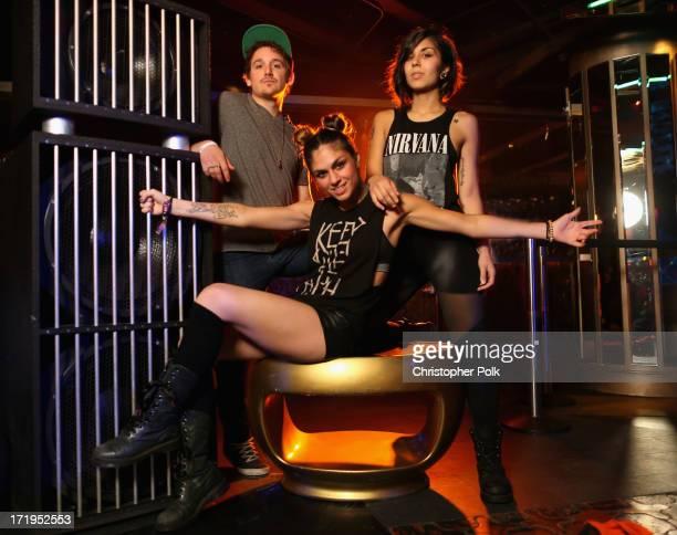 Kris 'Rain Man' Trindl Jahan Yousaf and Yasmine Yousaf of Krewella pose in the Wonderwall Portrait Studio at the iHeartRadio Ultimate Pool Party...