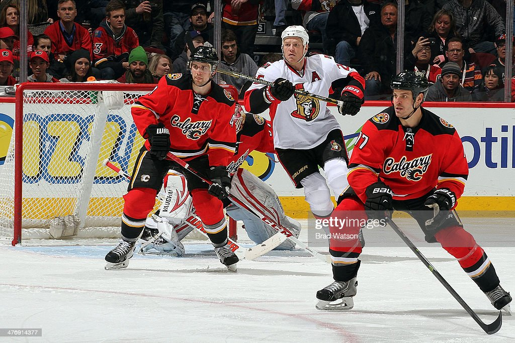 <a gi-track='captionPersonalityLinkClicked' href=/galleries/search?phrase=Kris+Russell&family=editorial&specificpeople=879805 ng-click='$event.stopPropagation()'>Kris Russell</a> #4 and <a gi-track='captionPersonalityLinkClicked' href=/galleries/search?phrase=Lance+Bouma&family=editorial&specificpeople=4303790 ng-click='$event.stopPropagation()'>Lance Bouma</a> #17 of the Calgary Flames skate against Chris Neil #25 of the Ottawa Senators at Scotiabank Saddledome on March 5, 2014 in Calgary, Alberta, Canada.
