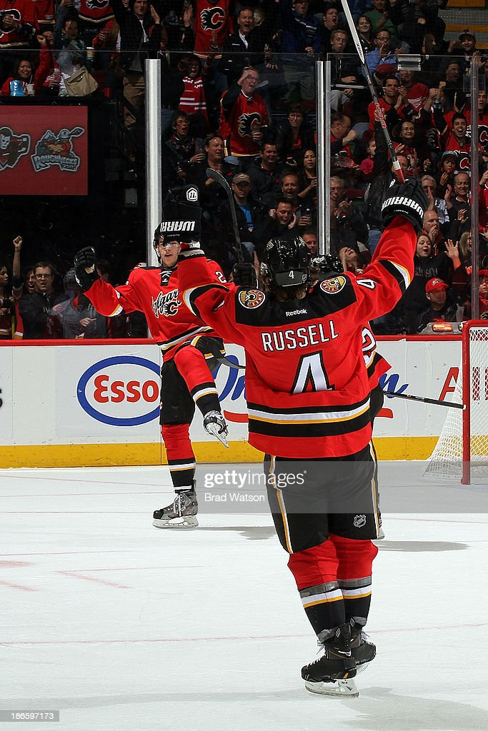 <a gi-track='captionPersonalityLinkClicked' href=/galleries/search?phrase=Kris+Russell&family=editorial&specificpeople=879805 ng-click='$event.stopPropagation()'>Kris Russell</a> #4 and Sean Monahan #23 of the Calgary Flames celebrate a goal against the Detroit Red Wings at Scotiabank Saddledome on November 1, 2013 in Calgary, Alberta, Canada.