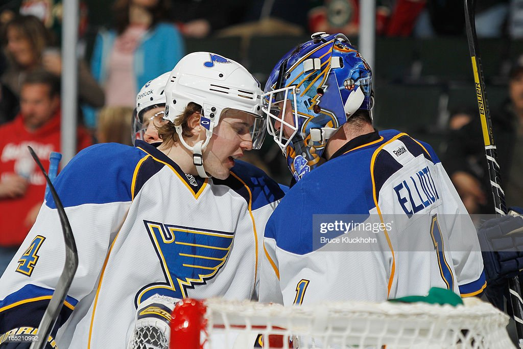 <a gi-track='captionPersonalityLinkClicked' href=/galleries/search?phrase=Kris+Russell&family=editorial&specificpeople=879805 ng-click='$event.stopPropagation()'>Kris Russell</a> #4 celebrates with his St. Louis Blues teammate <a gi-track='captionPersonalityLinkClicked' href=/galleries/search?phrase=Brian+Elliott&family=editorial&specificpeople=687032 ng-click='$event.stopPropagation()'>Brian Elliott</a> #1 after defeating the Minnesota Wild on April 1, 2013 at the Xcel Energy Center in Saint Paul, Minnesota.