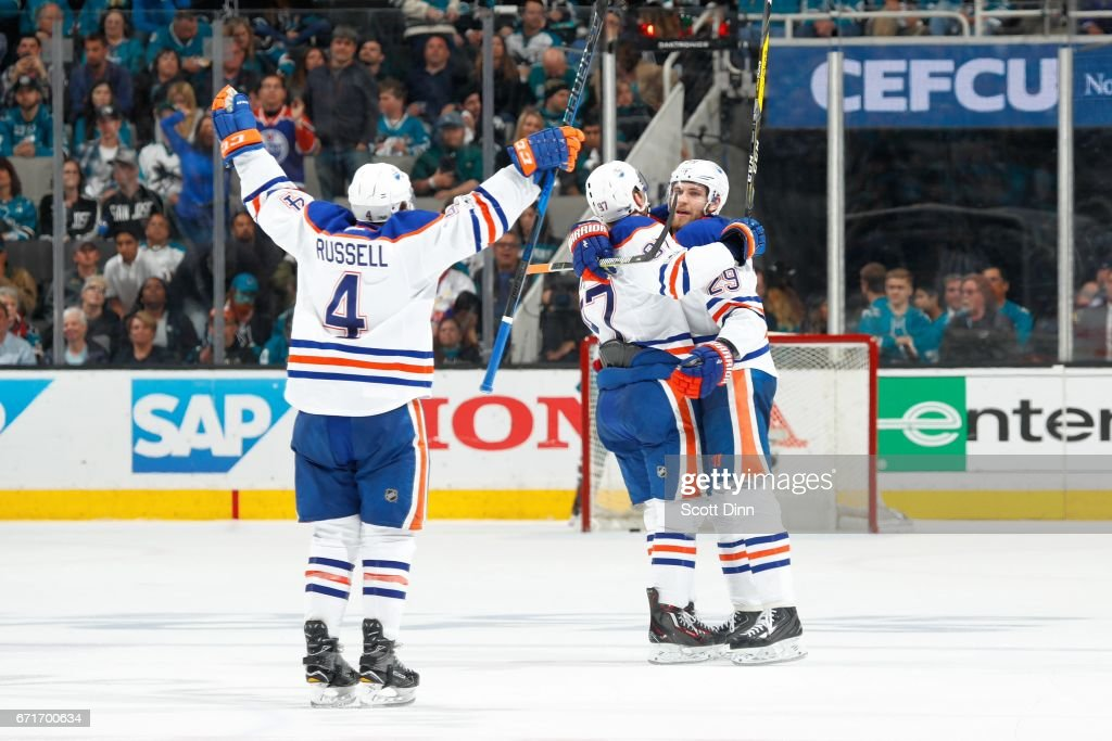 Kris Russell #4, Connor McDavid #97, and Leon Draisaitl #29 of the Edmonton Oilers react after winning against the San Jose Sharks in Game Six of the Western Conference First Round during the 2017 NHL Stanley Cup Playoffs at SAP Center at San Jose on April 22, 2017 in San Jose, California.