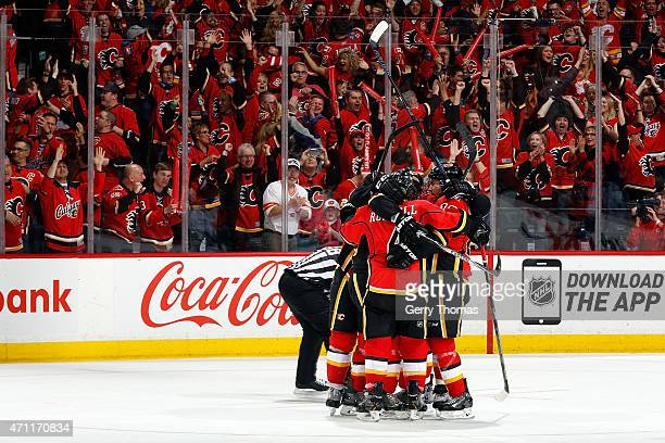 Kris Russell David Jones and teammates of the Calgary Flames celebrate a goal against the Vancouver Canucks at Scotiabank Saddledome for Game Six of...