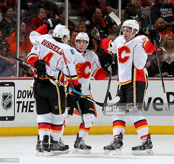 Kris Russell Jiri Hudler Johnny Gaudreau and Sean Monahan of the Calgary Flames celebrate Hudler's first period goal against the Anaheim Ducks in...