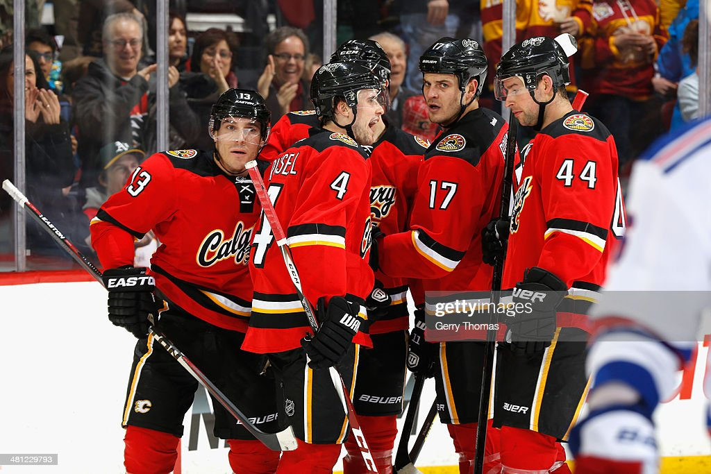 <a gi-track='captionPersonalityLinkClicked' href=/galleries/search?phrase=Kris+Russell&family=editorial&specificpeople=879805 ng-click='$event.stopPropagation()'>Kris Russell</a> #4, Michael Cammalleri #13, <a gi-track='captionPersonalityLinkClicked' href=/galleries/search?phrase=Lance+Bouma&family=editorial&specificpeople=4303790 ng-click='$event.stopPropagation()'>Lance Bouma</a> #17 and Chris Butler #44 of the Calgary Flames celebrate a goal against the New York Rangers at Scotiabank Saddledome on March 28, 2014 in Calgary, Alberta, Canada.