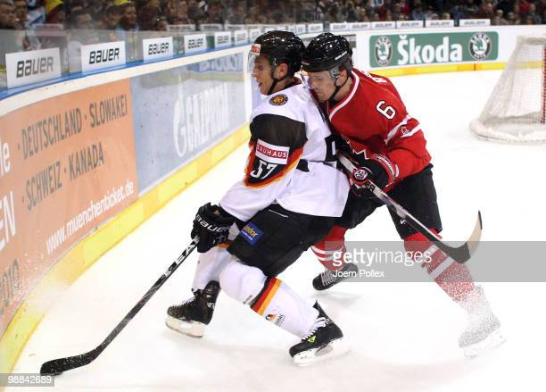 Kris Russell of Canada challenges Marcel Goc of Germany during the pre IIHF World Championship match between Germany and Canada at the O2 World...