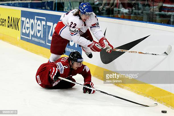 Kris Russell of Canada is challenged by Lukas Kaspar of Czech Republic during the IIHF World Championship group F qualification round match between...