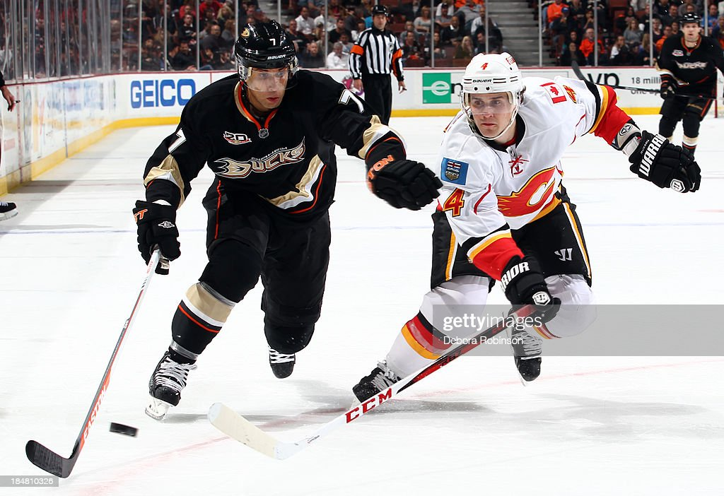 <a gi-track='captionPersonalityLinkClicked' href=/galleries/search?phrase=Kris+Russell&family=editorial&specificpeople=879805 ng-click='$event.stopPropagation()'>Kris Russell</a> #4 of the Calgary Flames battles for the puck against <a gi-track='captionPersonalityLinkClicked' href=/galleries/search?phrase=Andrew+Cogliano&family=editorial&specificpeople=869296 ng-click='$event.stopPropagation()'>Andrew Cogliano</a> #7 of the Anaheim Ducks on October 16, 2013 at Honda Center in Anaheim, California.