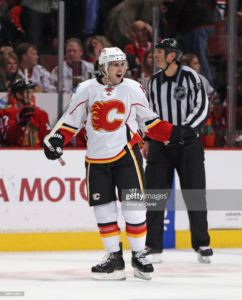 <a gi-track='captionPersonalityLinkClicked' href=/galleries/search?phrase=Kris+Russell&family=editorial&specificpeople=879805 ng-click='$event.stopPropagation()'>Kris Russell</a> #4 of the Calgary Flames celebrates his game-winning overtime goal against the Chicago Blackhawks at the United Center on November 3, 2013 in Chicago, Illinois. The Flames defeated the Blackhawks 3-2 in overtime.