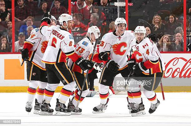 Kris Russell of the Calgary Flames celebrates his second goal of the game against Ottawa Senators with teammates Jiri Hudler Dennis Wideman Johnny...
