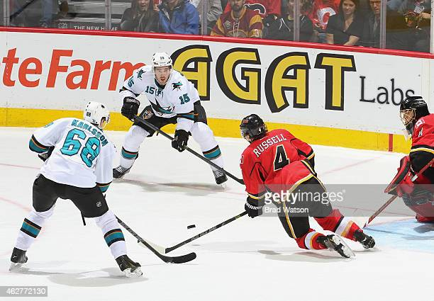 Kris Russell of the Calgary Flames gets down to block a pass against James Sheppard of the San Jose Sharks at Scotiabank Saddledome on February 4...