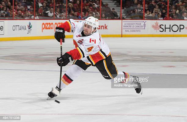 Kris Russell of the Calgary Flames shoots the puck against Ottawa Senators at Canadian Tire Centre on October 28 2015 in Ottawa Ontario Canada