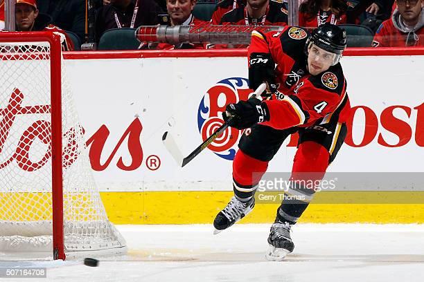 Kris Russell of the Calgary Flames shoots the puck against the Nashville Predators during an NHL game at Scotiabank Saddledome on January 27 2016 in...
